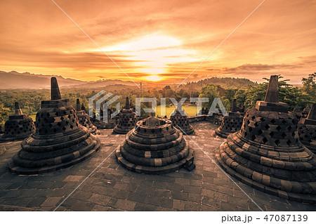Dramatic sunset Borobudur Temple at sunset Yogyakarta, Java, Indonesia. 47087139