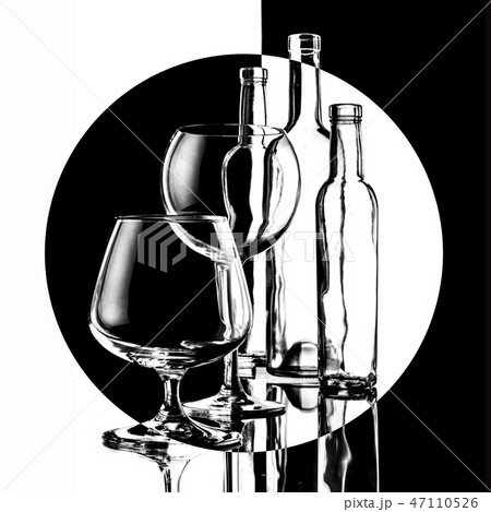 glasses and bottles for brandy and wine in the background 47110526
