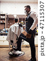 Hipster man client visiting haidresser and hairstylist in barber shop. 47115307