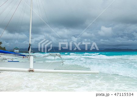 Filipino boat in the azure sea at cloudy day, Boracay, Philippines 47115534
