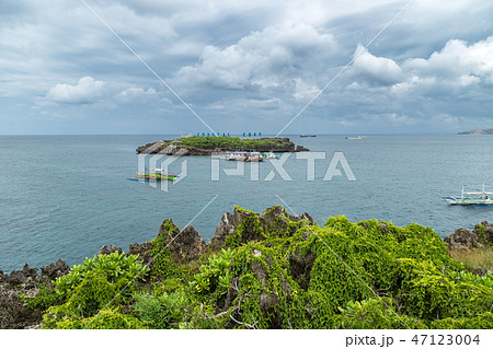 Panorama of Crystal Cove small island and tourist boats near Boracay island in the Philippines 47123004