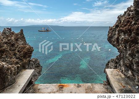 Landscape azure sea and a rocky coast Crystal Cove small island near Boracay island in the 47123022