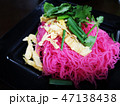 pink fried noodles with sliced omelette on the top 47138438