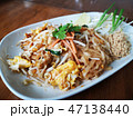 fried noodles with omelette mixed together 47138440