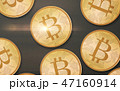 gold bitcoins over gray background from top 47160914