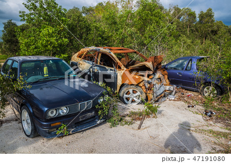 Broken cars in a dump in the field on Koh Samui in Thailand. 47191080