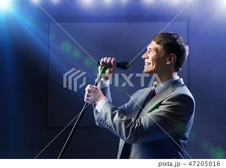 Businessman with microphone 47205016