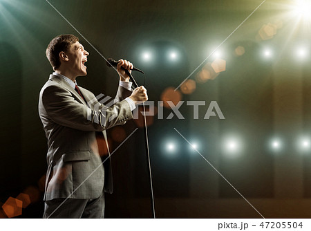 Businessman with microphone 47205504
