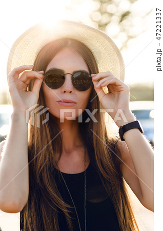 Stylish girl standing near road wearing short 47221337