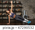 Fitness woman doing side plank during yoga workout at home 47290532