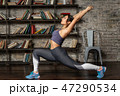 Young fitness woman doing front lunge during yoga exercise 47290534