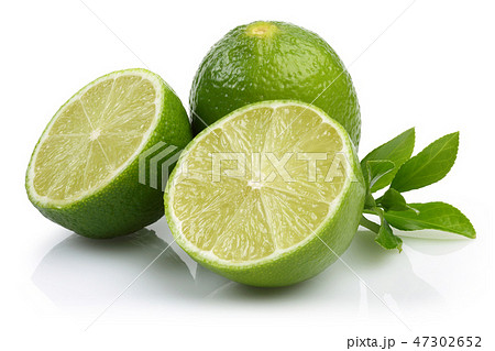 Sliced fresh lime fruits with leaves 47302652