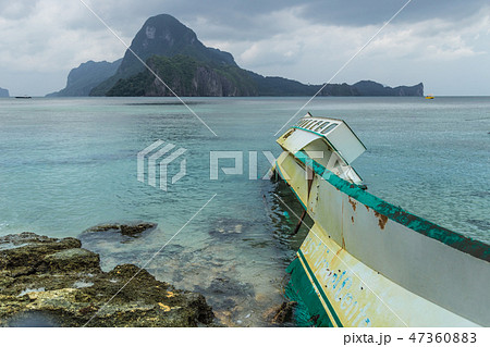 Broken fishing boat stranded after typhoon in rainy weather in El Nido, Palawan, Philippines 47360883