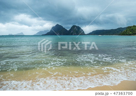 Landscape of Palawan, El Nido. Ocean and rock islands in background. Cloudy stormy sky after taifun 47363700