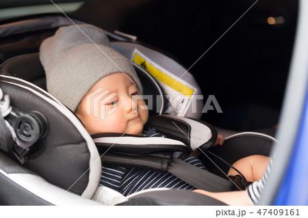 Portrait of baby boy sitting in car seat 47409161