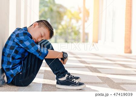 Depressed asian boy. Young asian boy sad 47419039