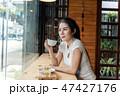 Asian woman hands holding coffee mug 47427176