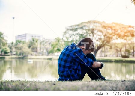 Depressed asian boy. Young asian boy sad 47427187
