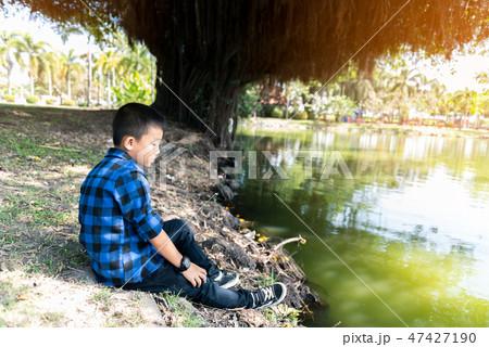 Depressed asian boy. Young asian boy sad 47427190