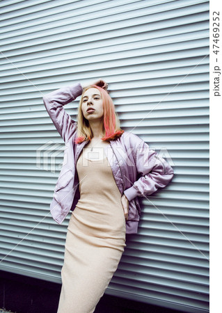young pretty fashion dressed blong teenage girl posing friendly street style, lifestyle people 47469252