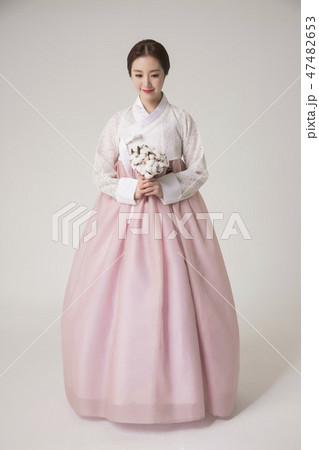 Korean beauty concept photo. Young beautiful woman wearing Hanbok, Korean traditional dress. 021 47482653