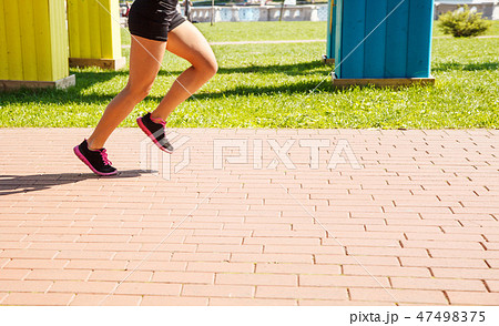 legs of girl running in a sports competition 47498375