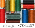 Colorful spools of thread close-up on white table 47541137