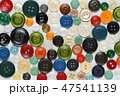 Old colorful sewing buttons on white table 47541139