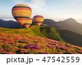 Air ballon above mountains 47542559