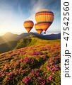 Air ballon above mountains 47542560