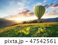 Air ballon above mountains 47542561