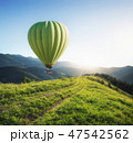 Air ballon above mountains 47542562