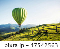 Air ballon above mountains 47542563
