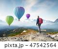 Mountain tourist on the high rock.  47542564