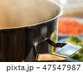 Steaming soup pot with broccoli and carrots 47547987
