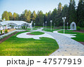 Image of the beautiful white wedding tent in forest 47577919