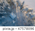 Aerial view of small hut in white snowy winter landscape 47578096