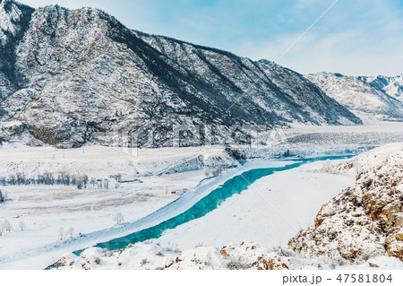 Winter snow river in mountains. Snow winter mountain river valley landscape. Winter snow river in 47581804