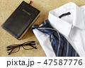 Man shirt with tie and Holy Bible 47587776