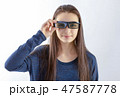 Teenager girl with 3d glasses looking at camera 47587778