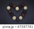 Chocolate truffles heart shape on black 47587781