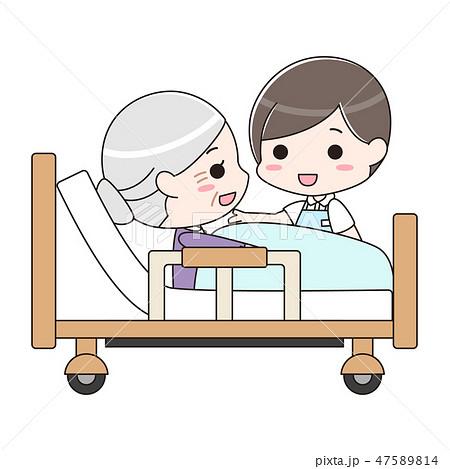 シニア女性を介護する男性介護士 47589814