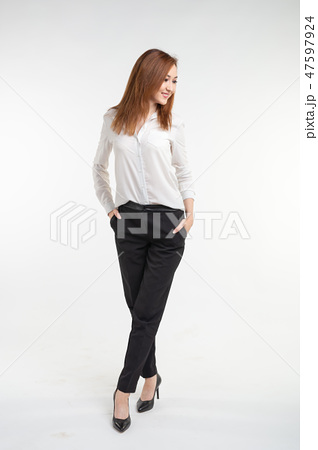 Portrait of fashionable beautiful asian woman in elegant clothes over white background 47597924