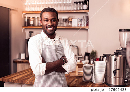 Joyful nice happy man wearing an apron 47605423