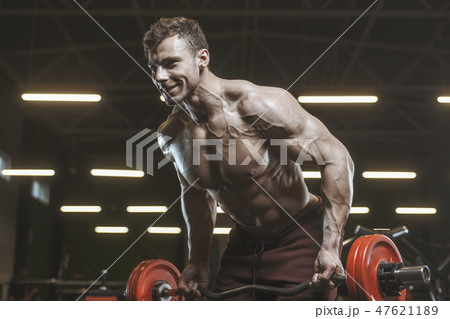 Handsome strong athletic men pumping up muscles workout bodybuil 47621189