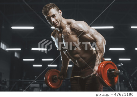 Handsome strong athletic men pumping up muscles workout bodybuil 47621190