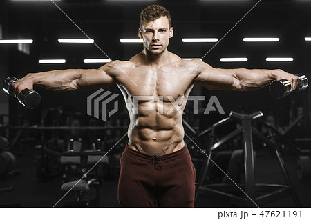 Handsome strong athletic men pumping up muscles workout bodybuil 47621191