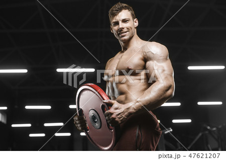 Handsome strong athletic men pumping up muscles workout bodybuil 47621207