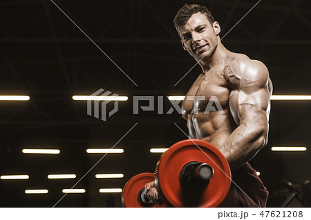 Handsome strong athletic men pumping up muscles workout barbell 47621208