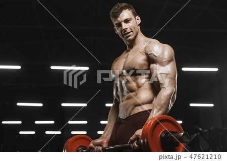 Handsome strong athletic men pumping up muscles workout barbell 47621210